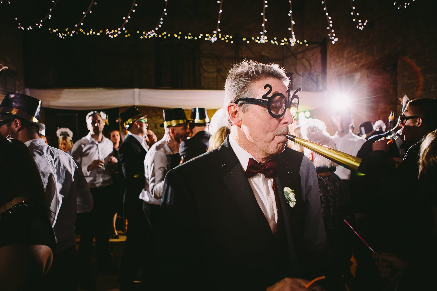 Guest wearing 2016 glasses and blowing a hooter
