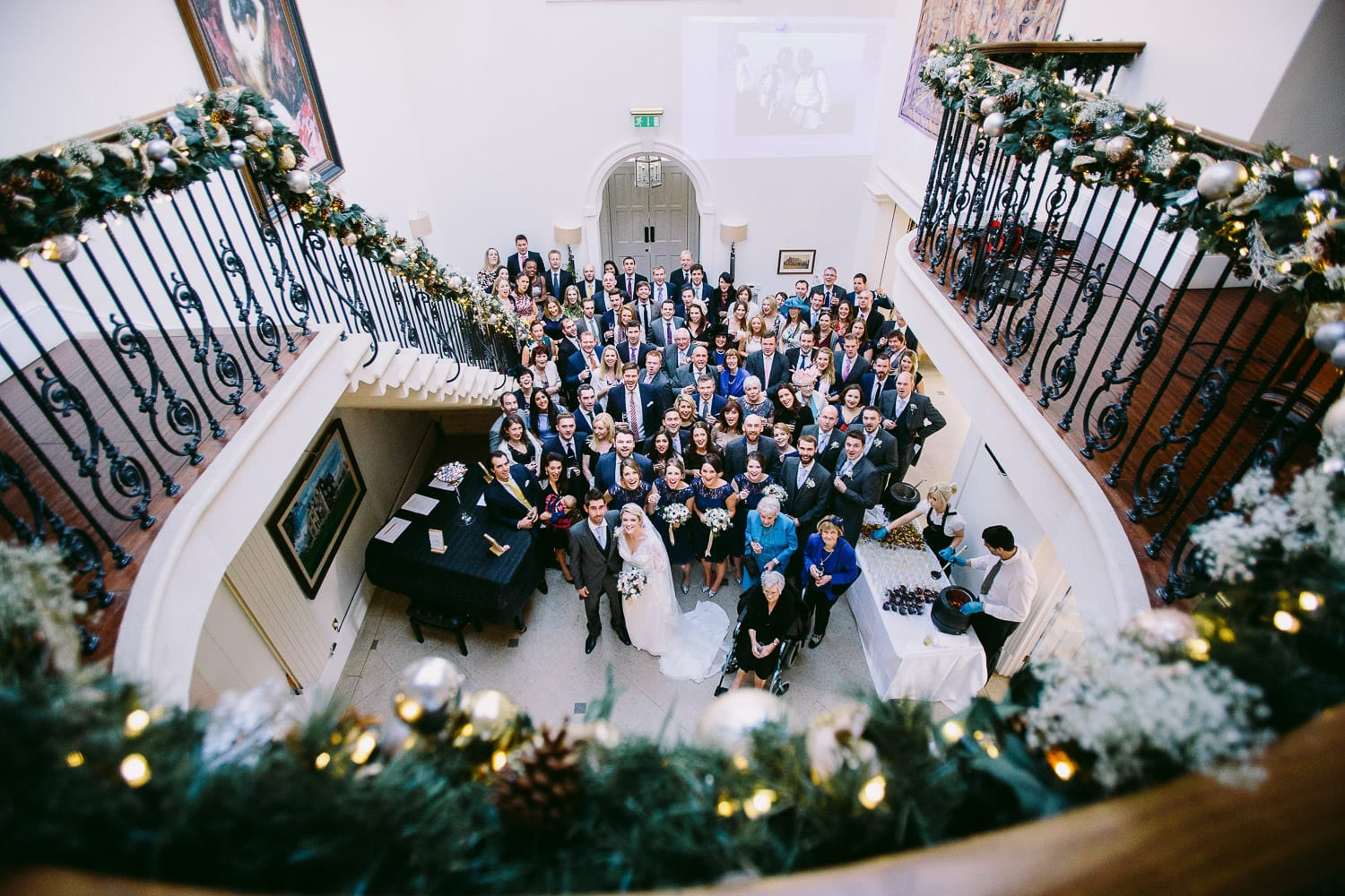 A group shot of all wedding guests shot from the balcony