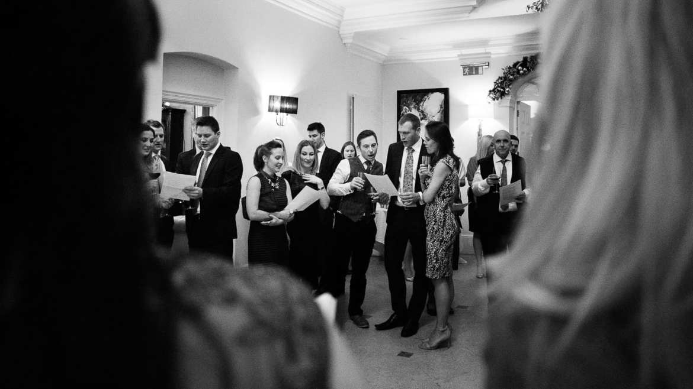 The weddings guests singing Christmas carols