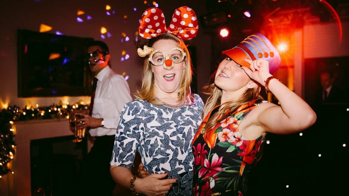 Guests dressed in Disney outfits on the dance floor