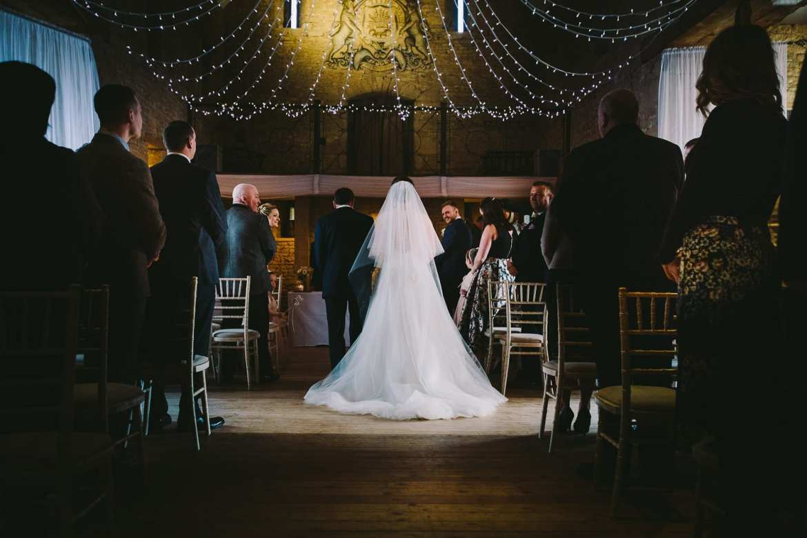 The groom turns to see his bride for the first time