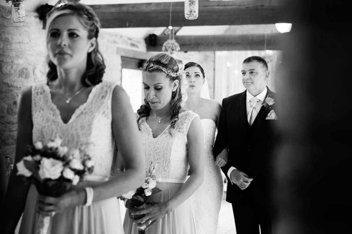 Nerves are starting to show as the bride prepares to enter the ceremony