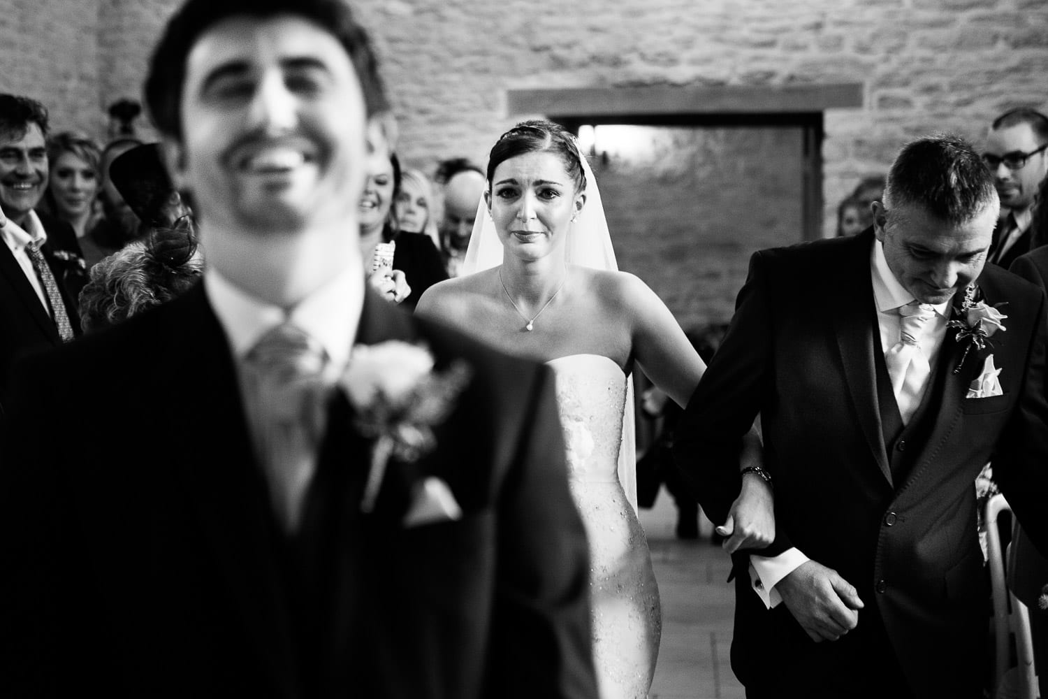 The groom laughs and the bride cries with emotion