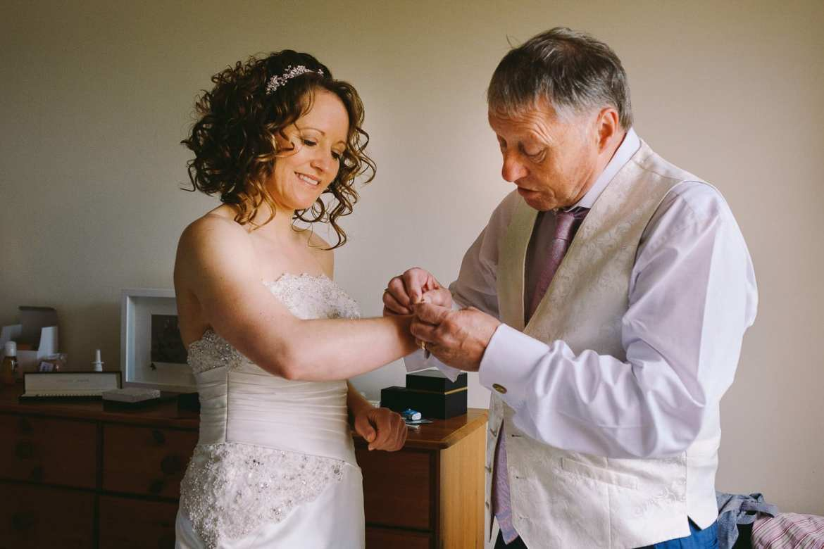 The Father of the Bride helps her get ready