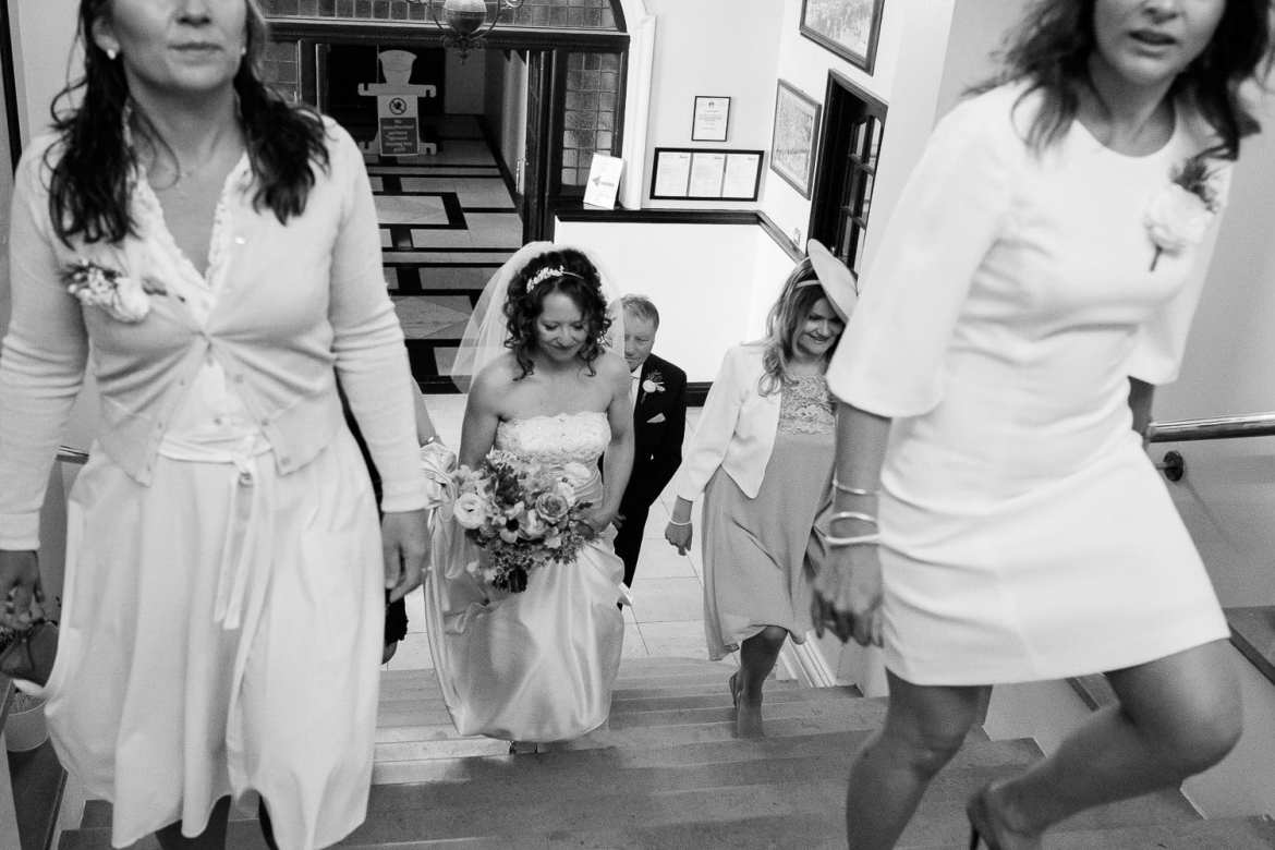 Bridal party walking up the steps inside Henley Town Hall