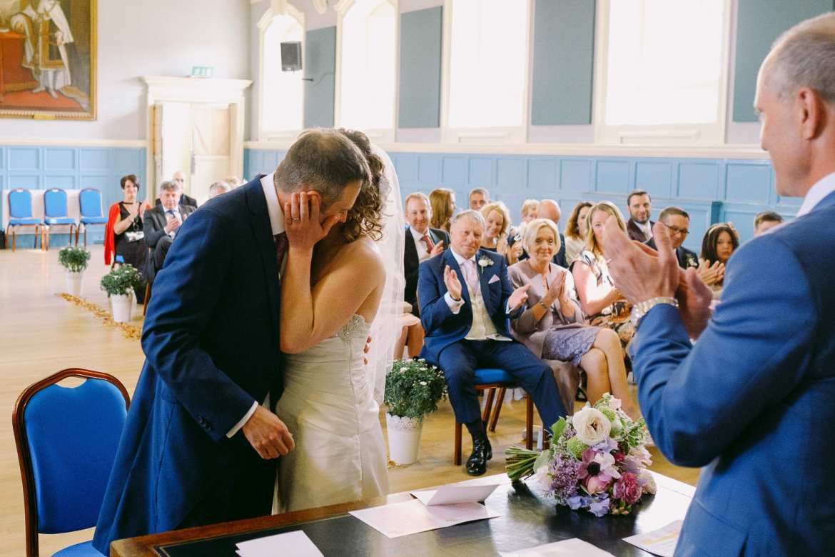 Bride giving the groom a kiss at Henley Town Hall