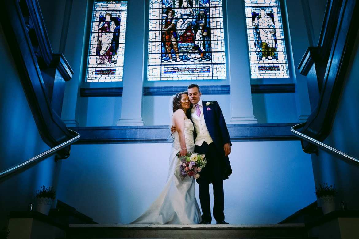 Bride and groom on the steps at Henley Town Hall