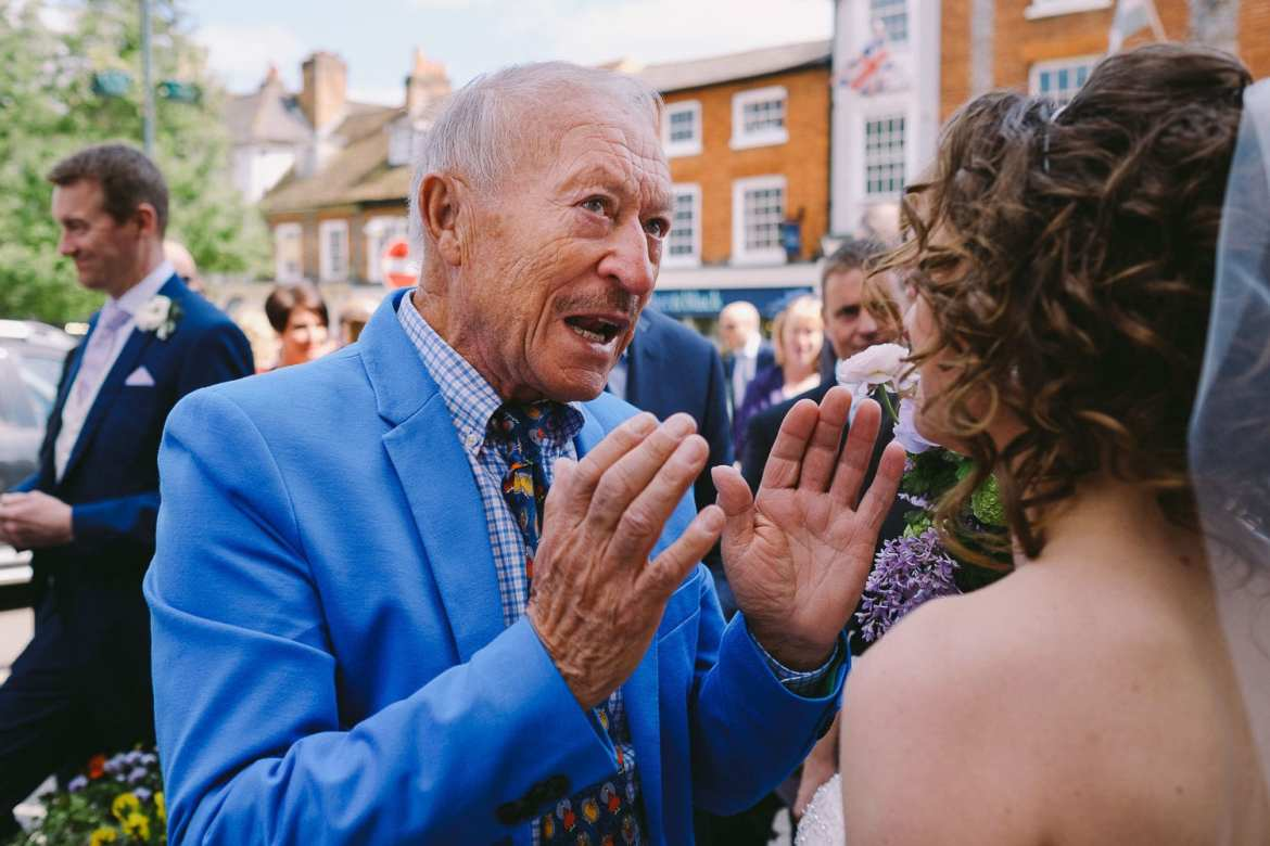 Wedding guests mingling outside Henley Town Hall