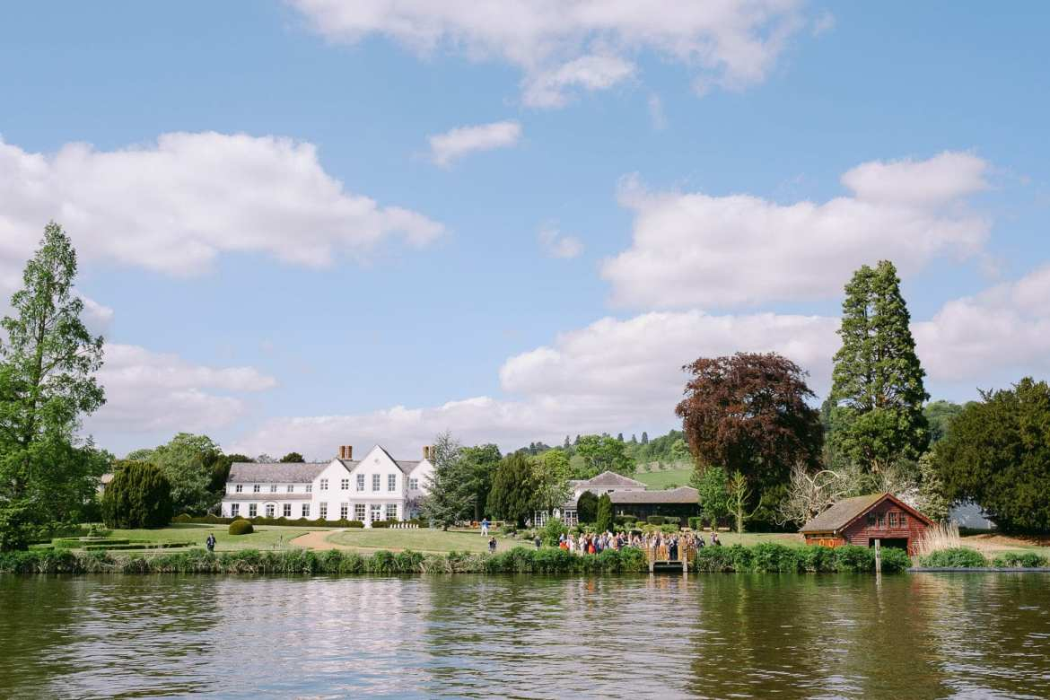 Guests waiting on the bank of the Thames at Greenlands for bride and groom