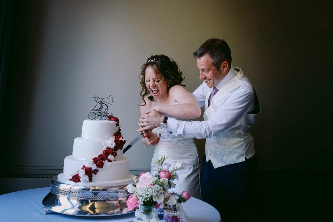 Bride and groom cutting their wedding cake at Greenlands