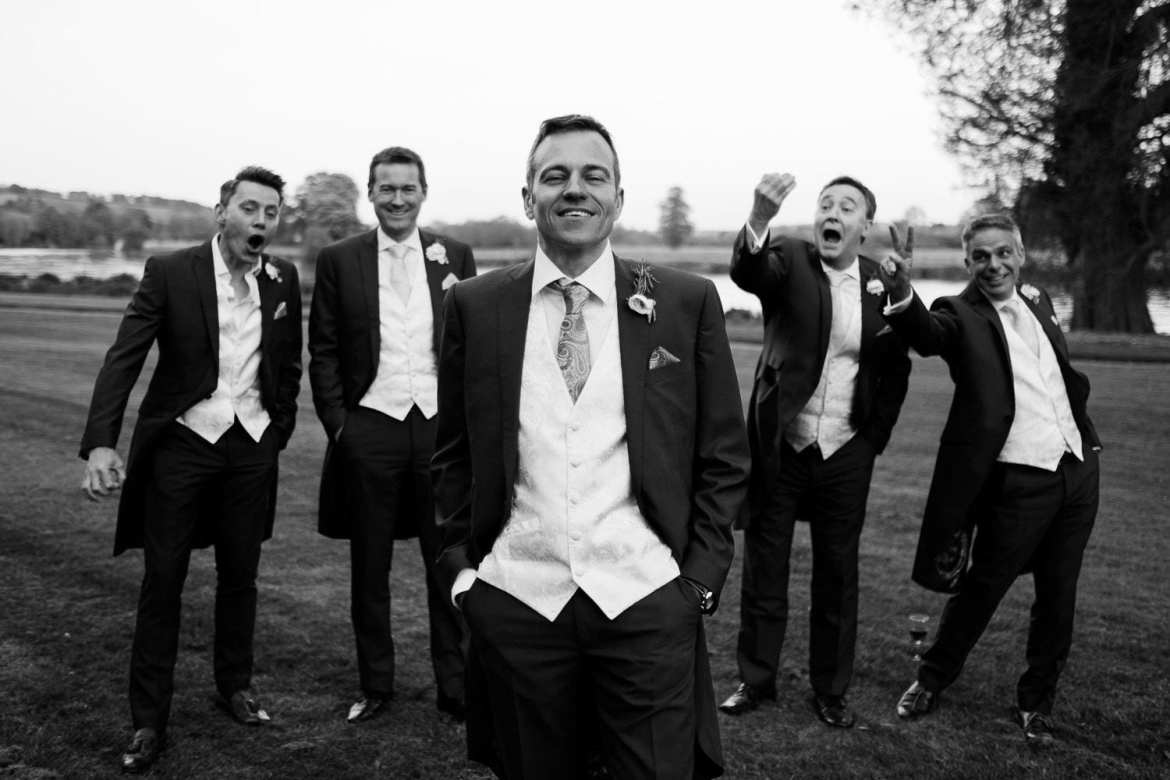 Groomsmen messing about during their picture with the groom at Greenlands