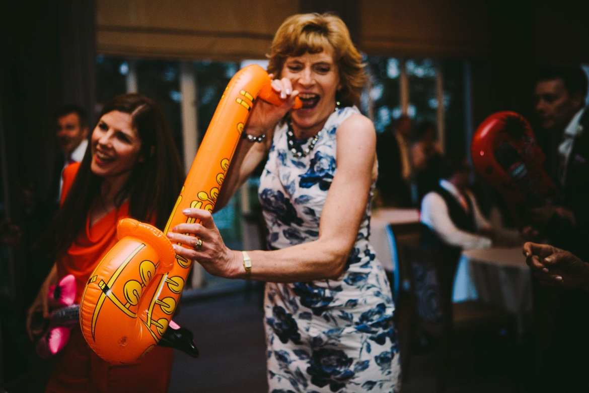 Guest dancing with blow up saxophone at Greenlands