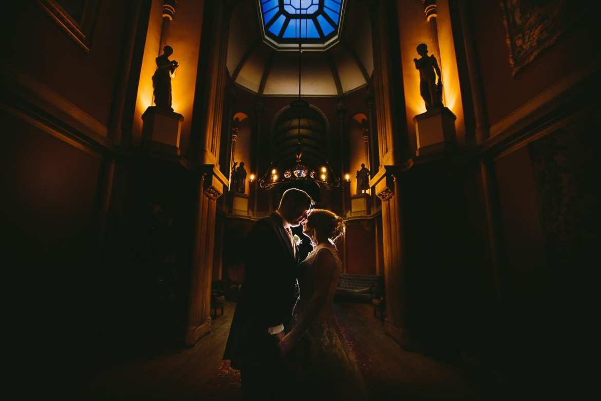 A dramatic backlit portrait of the bride and groom