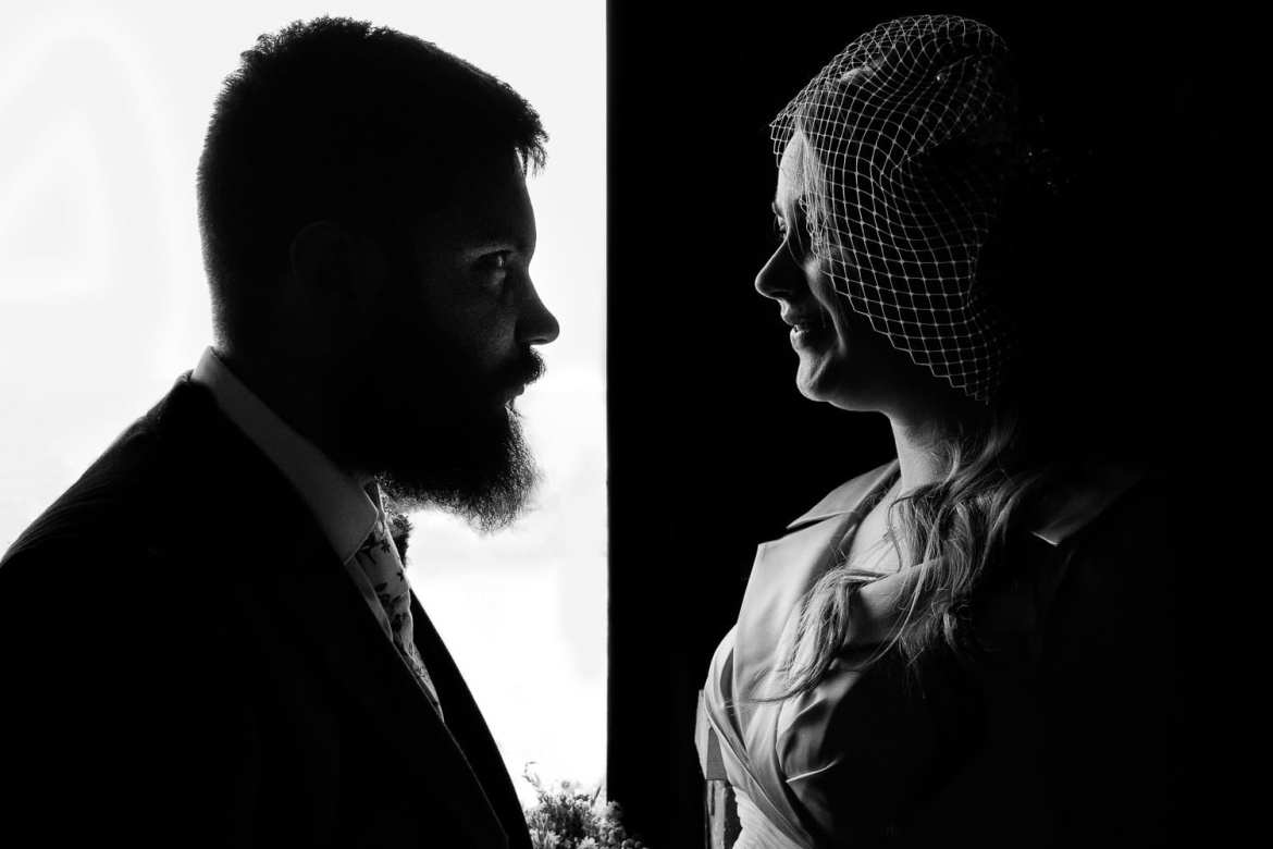 A silhouette portrait of the newly weds