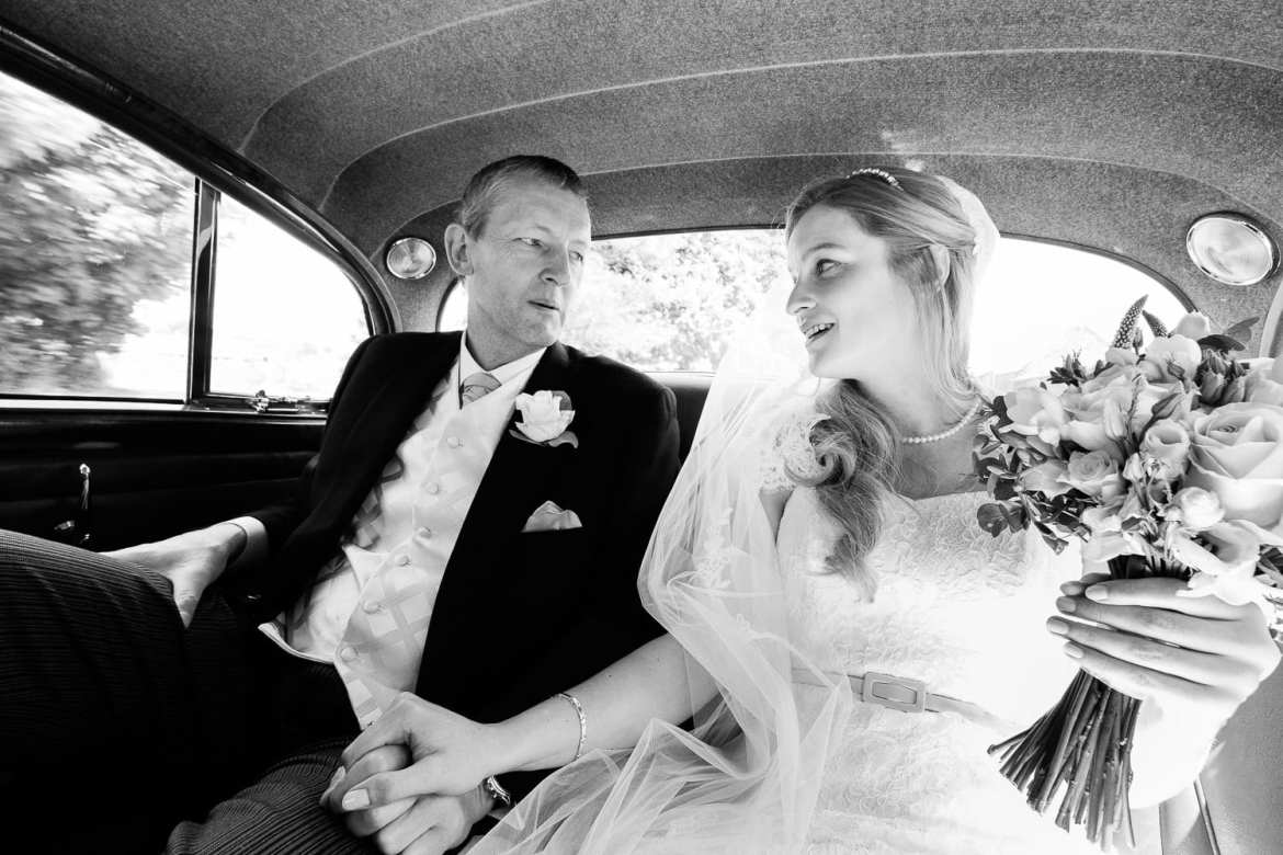 Bride and Father travel in the wedding car