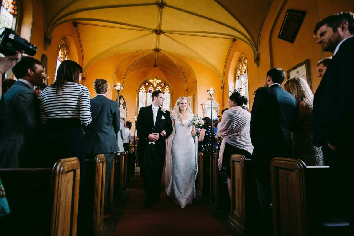 The bride and Groom leave the church
