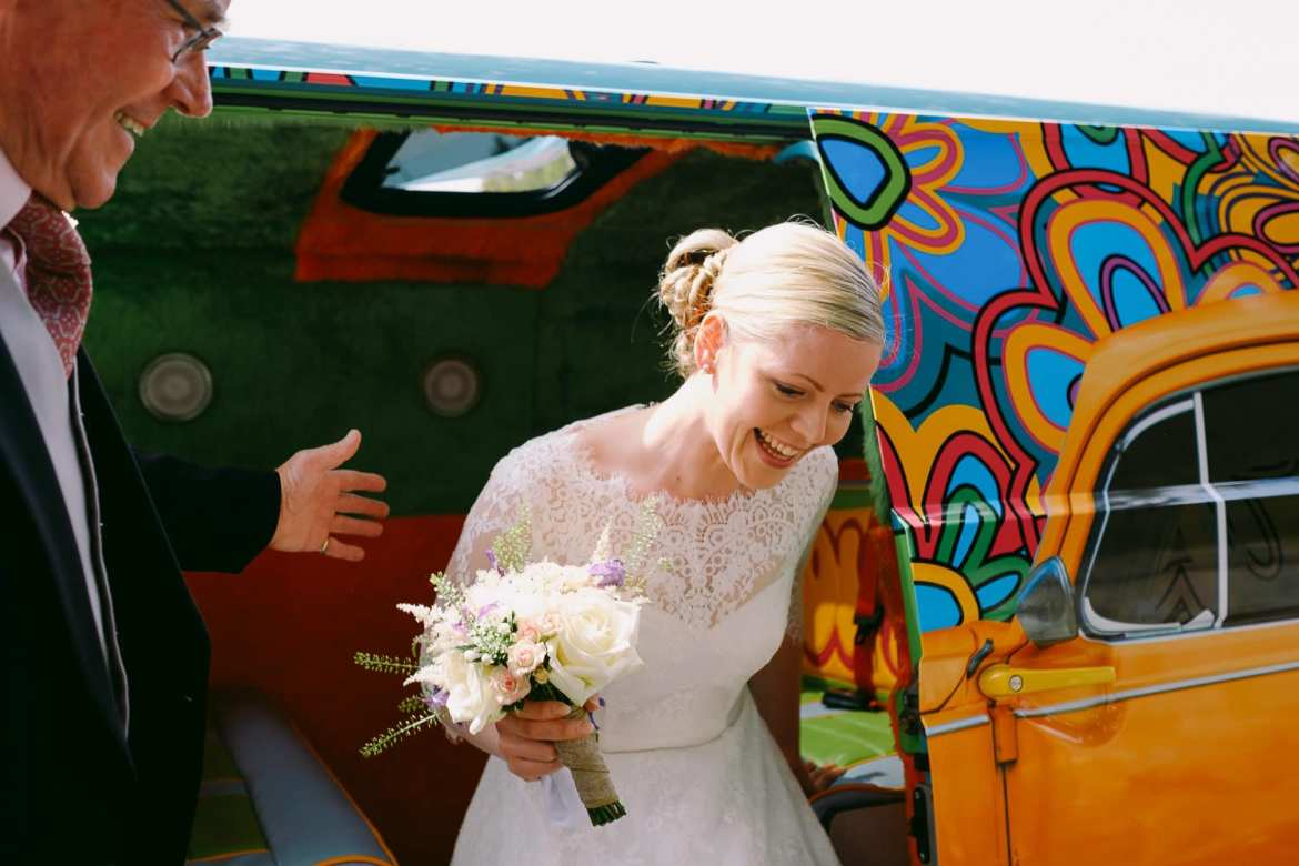 The bride arrives in a brightly coloured camper van