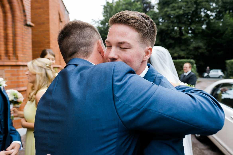 Hugs outside the church