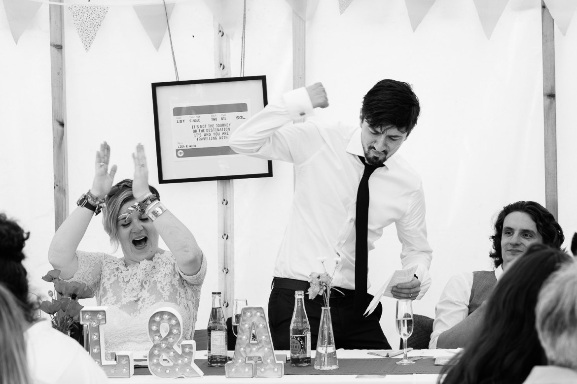 The groom gets animated during his speech