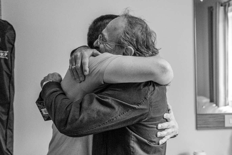 The groom hugs his dad