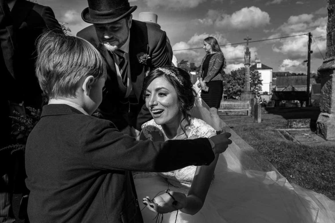 A child congratulated the bride and groom