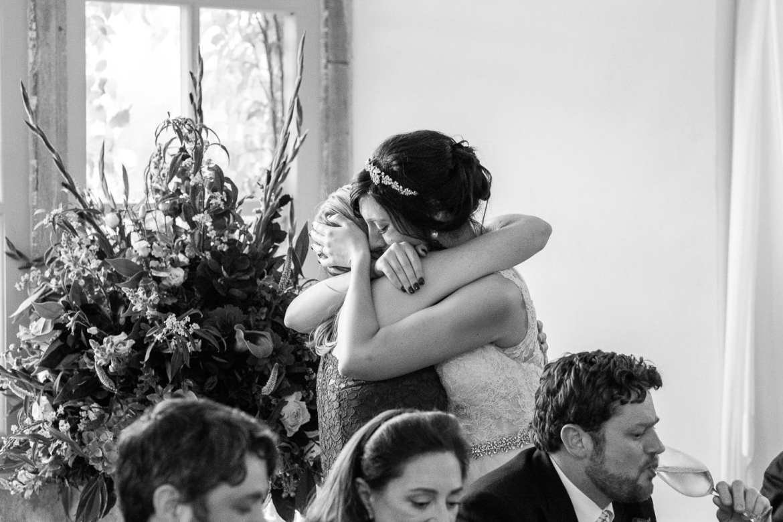 The bride hugs her sister