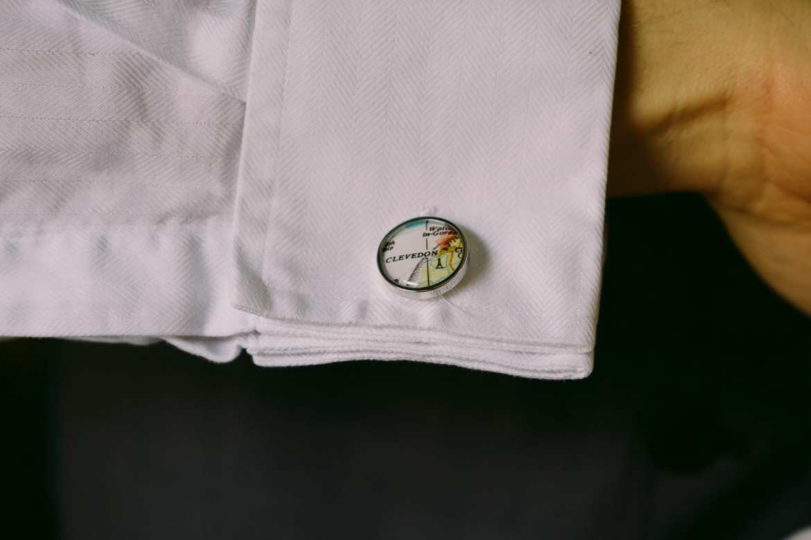 The grooms cufflinks showing a map of Clevedon