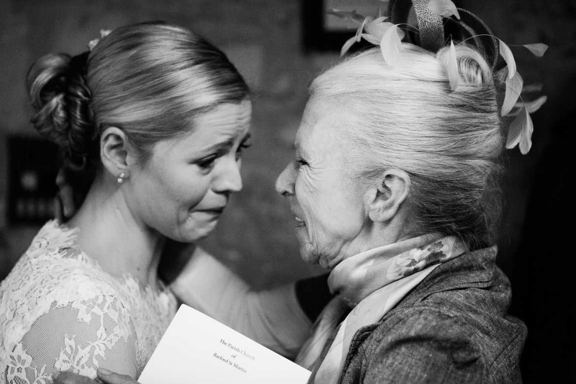 Emotional, crying bride with guest