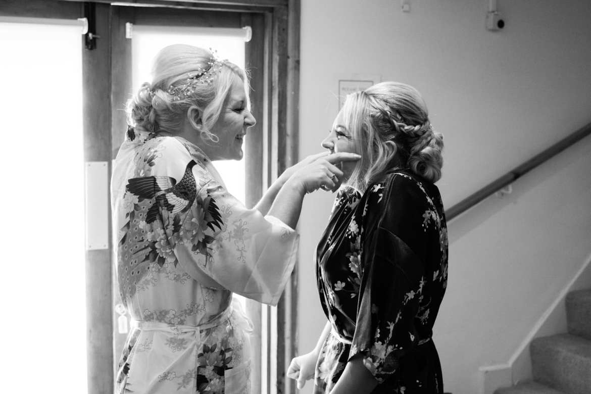 bride tickling bridesmaids face