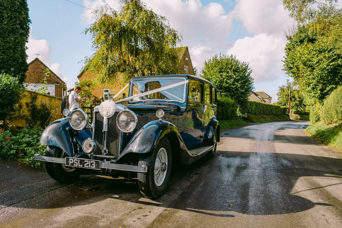 Bridal car ready to take bride and her father to Larmer Tree Gardens