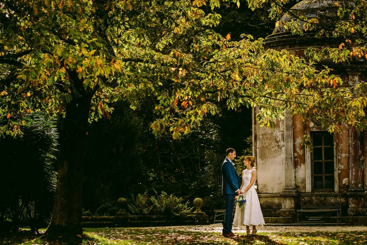 Autumnal shot of bride and groom in gardens