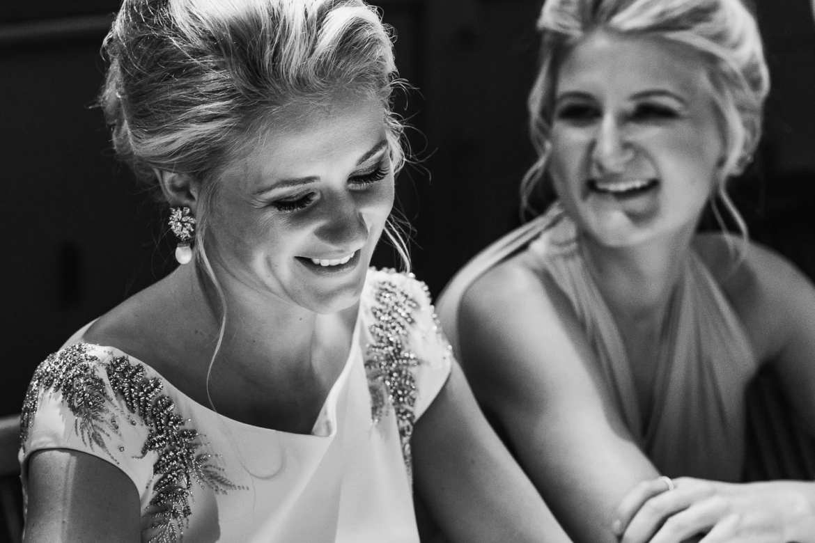 The bride and her sister laughing