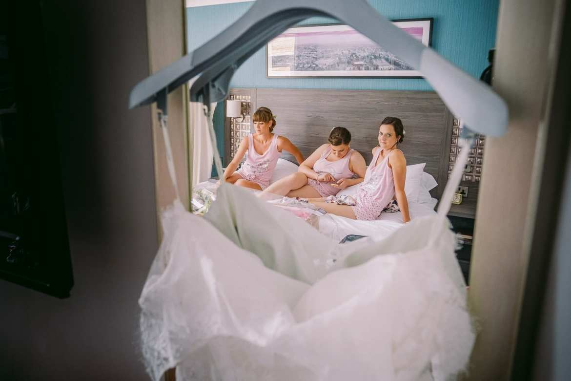 The bridesmaids reflected in a mirror