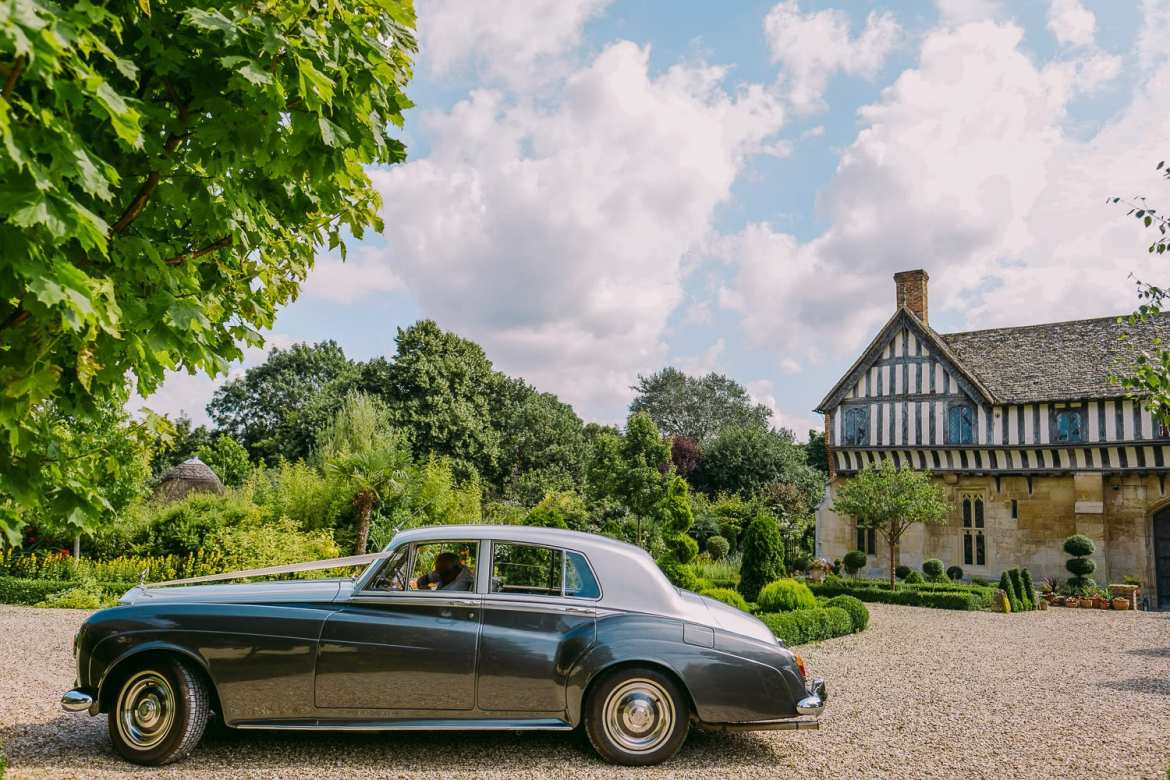 The wedding car arrives at Priors Tithe Barn