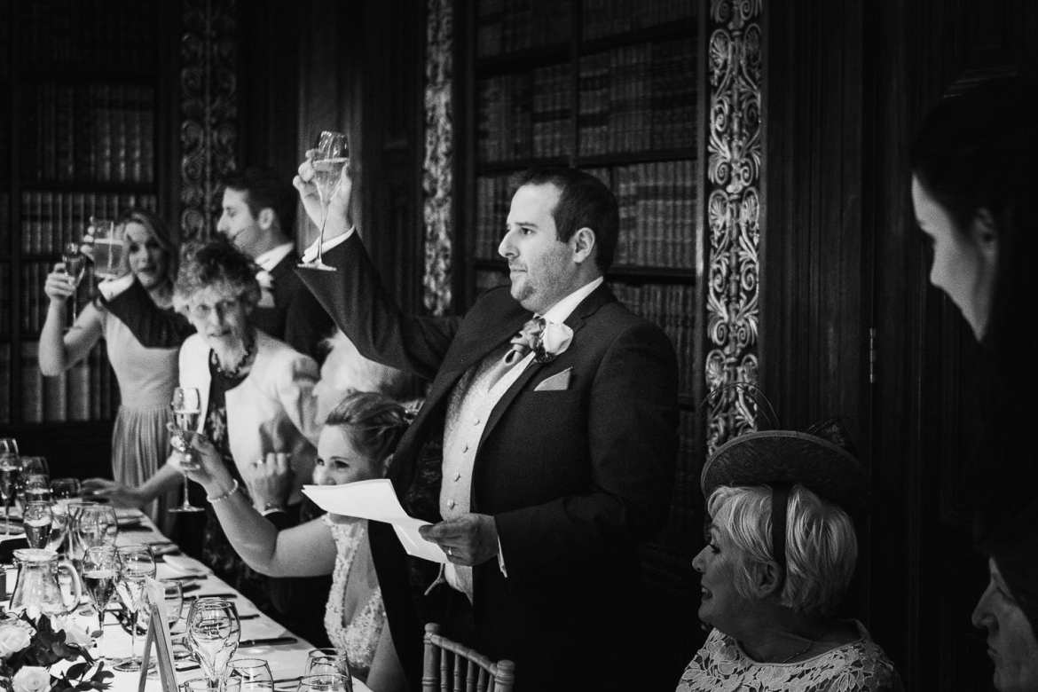 Groom raising a toast