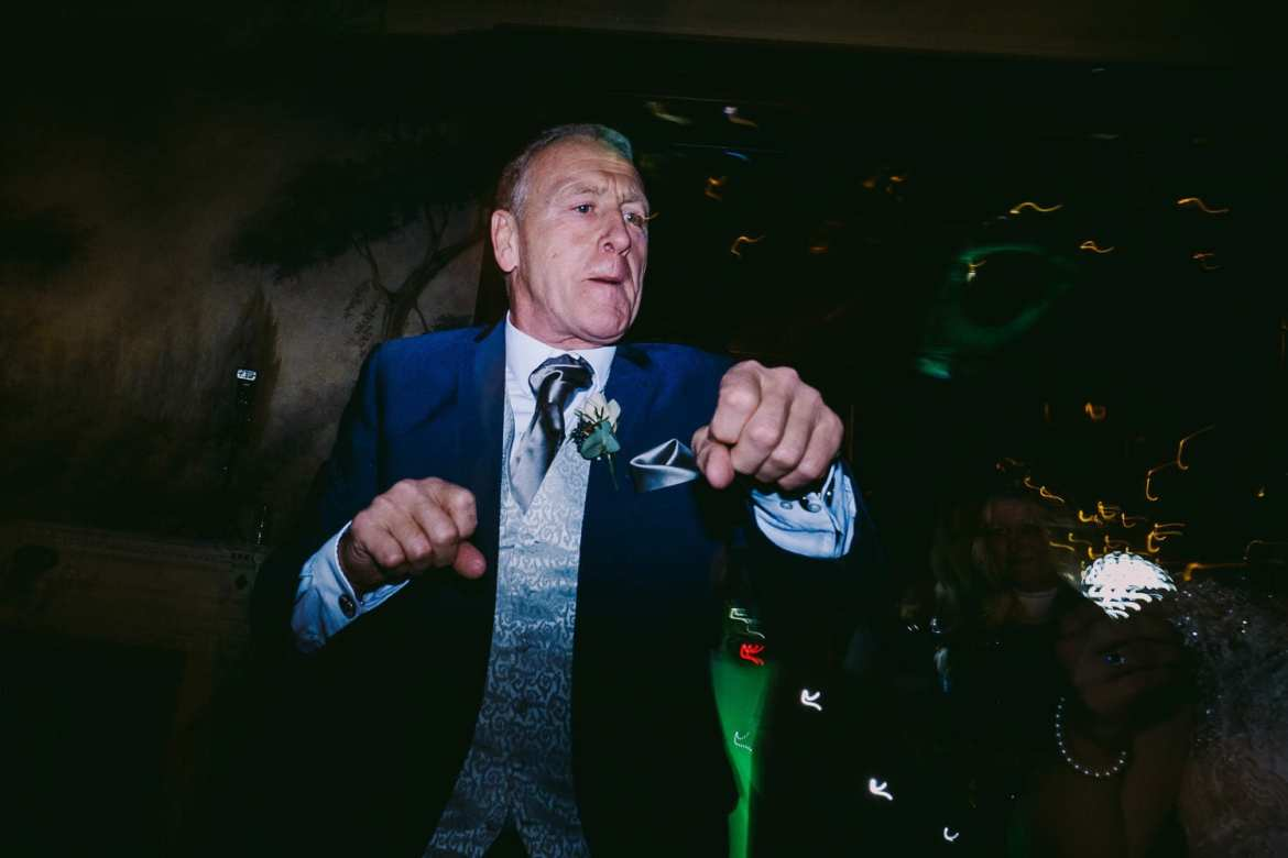 Brides father doing some moves on the dance floor