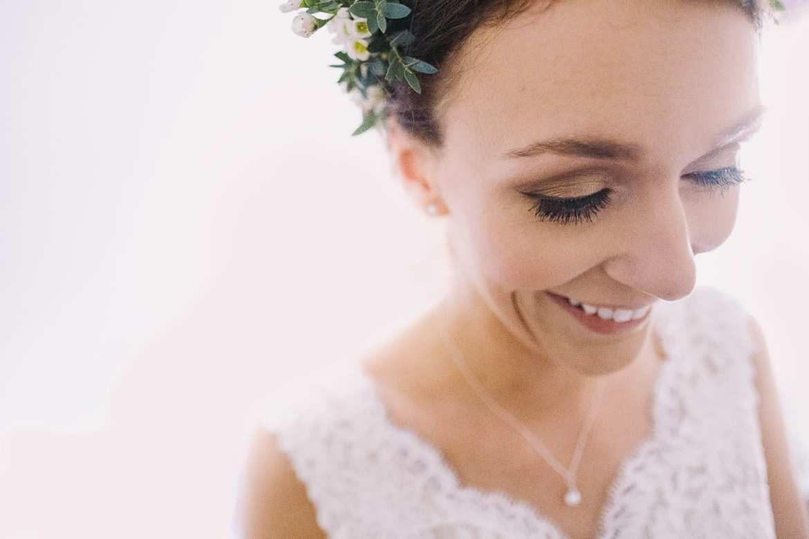 a close up of the bride smiling