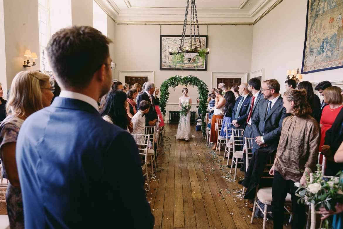 The bride makes her way down the aisle at Elmore Court