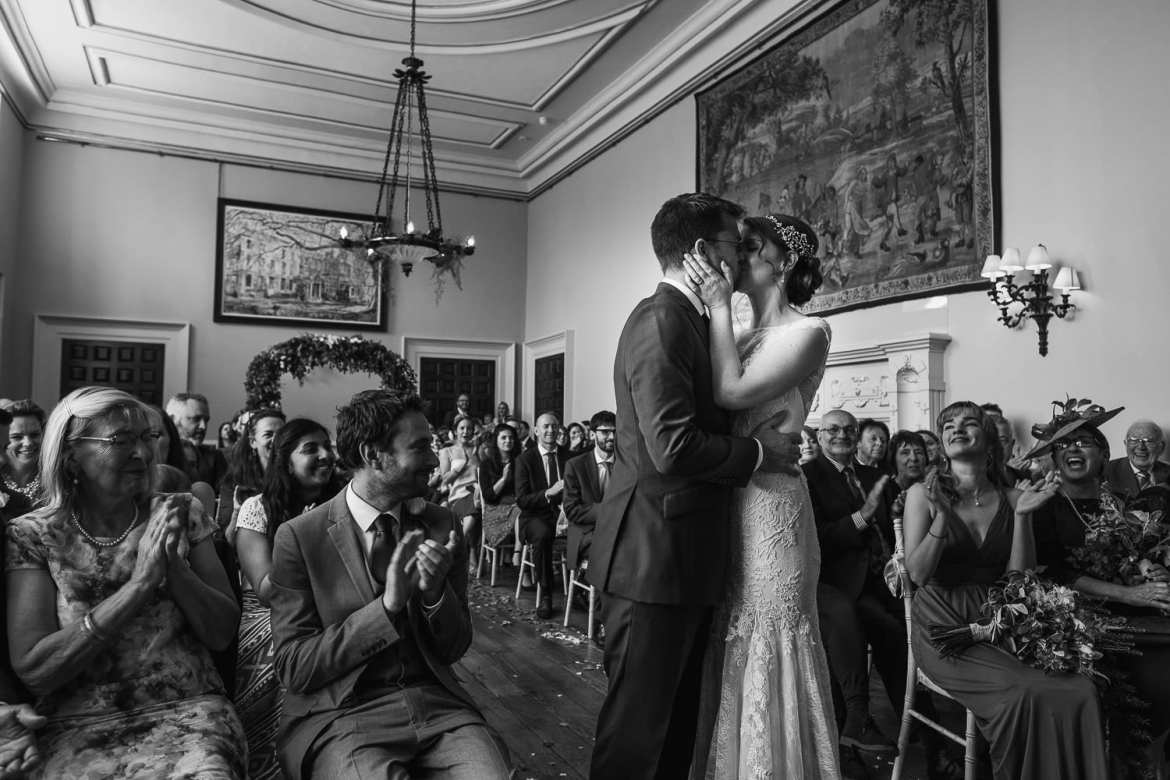 The first kiss after the wedding ceremony in the main house at Elmore Court