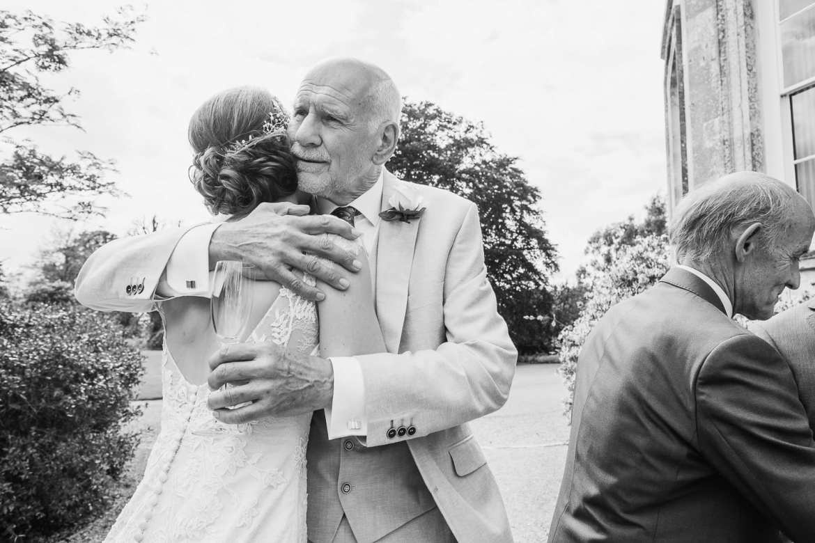 The father of the bride hugs his daughter