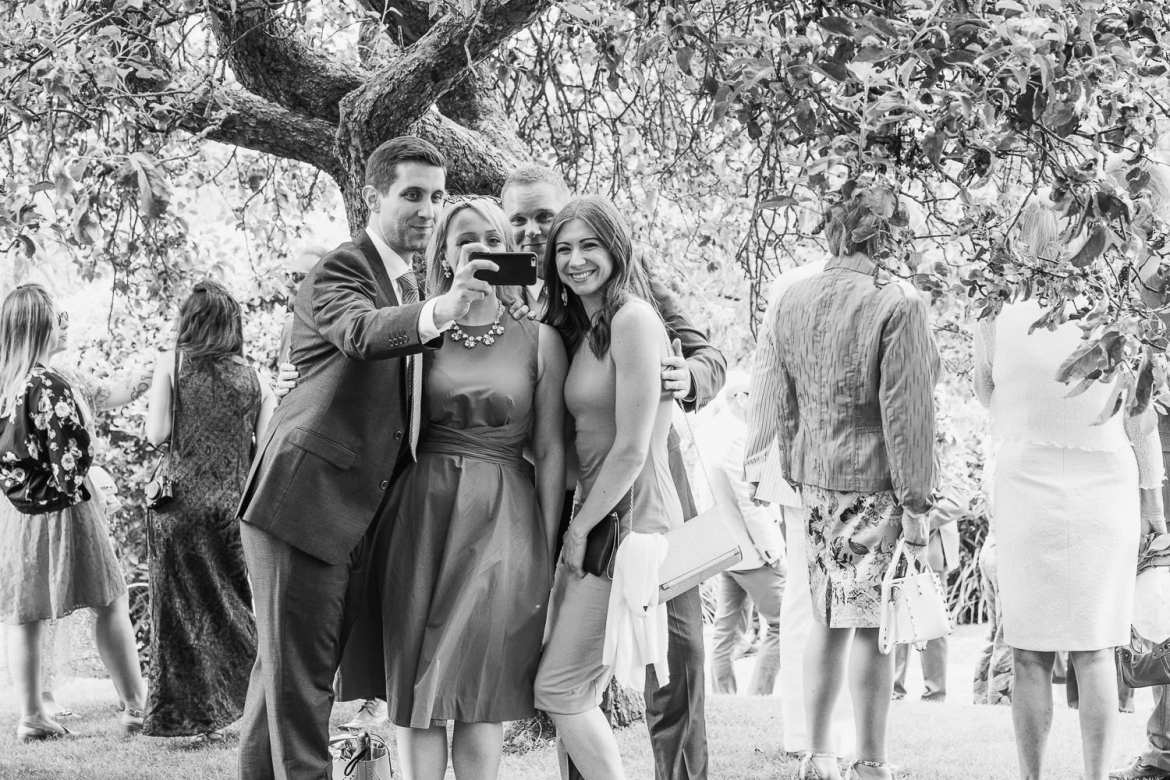 Wedding guests take a selfie