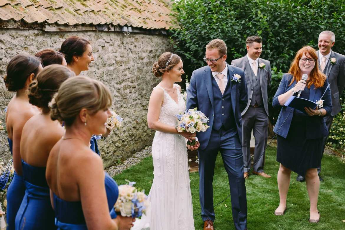 The bride and groom smiling at each other during the humanist wedding ceremony
