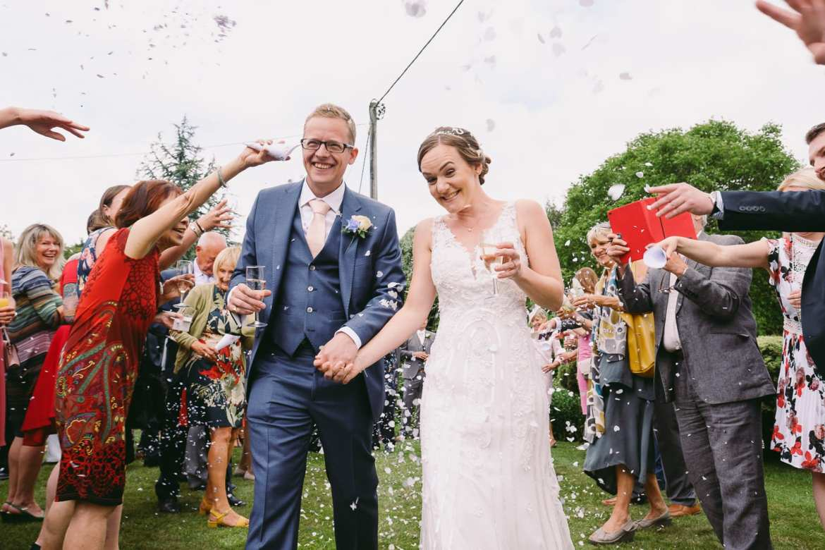 The couple are showered in confetti
