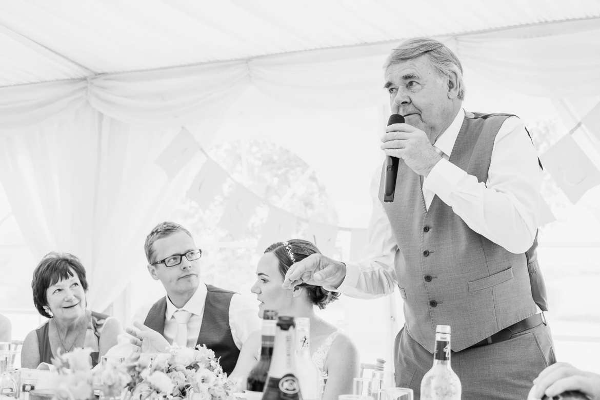 The father of the bride gives his speech while his wife looks on