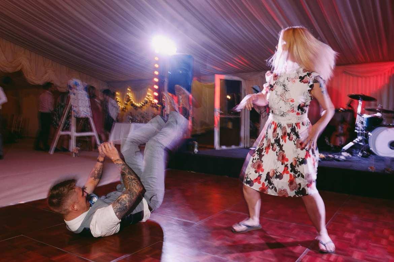 Drunk wedding guests dancing