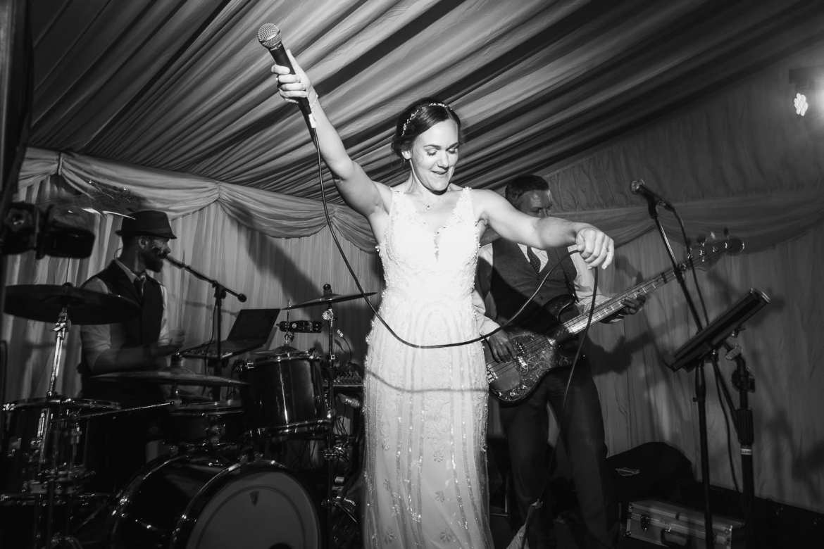 The bride singing with the wedding band