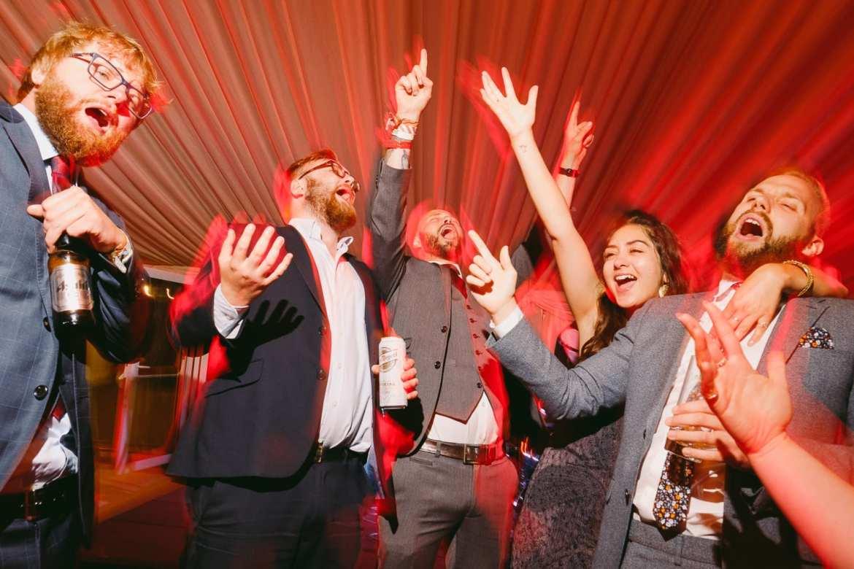 Wedding guests singing Living on a prayer by Bon Jovi