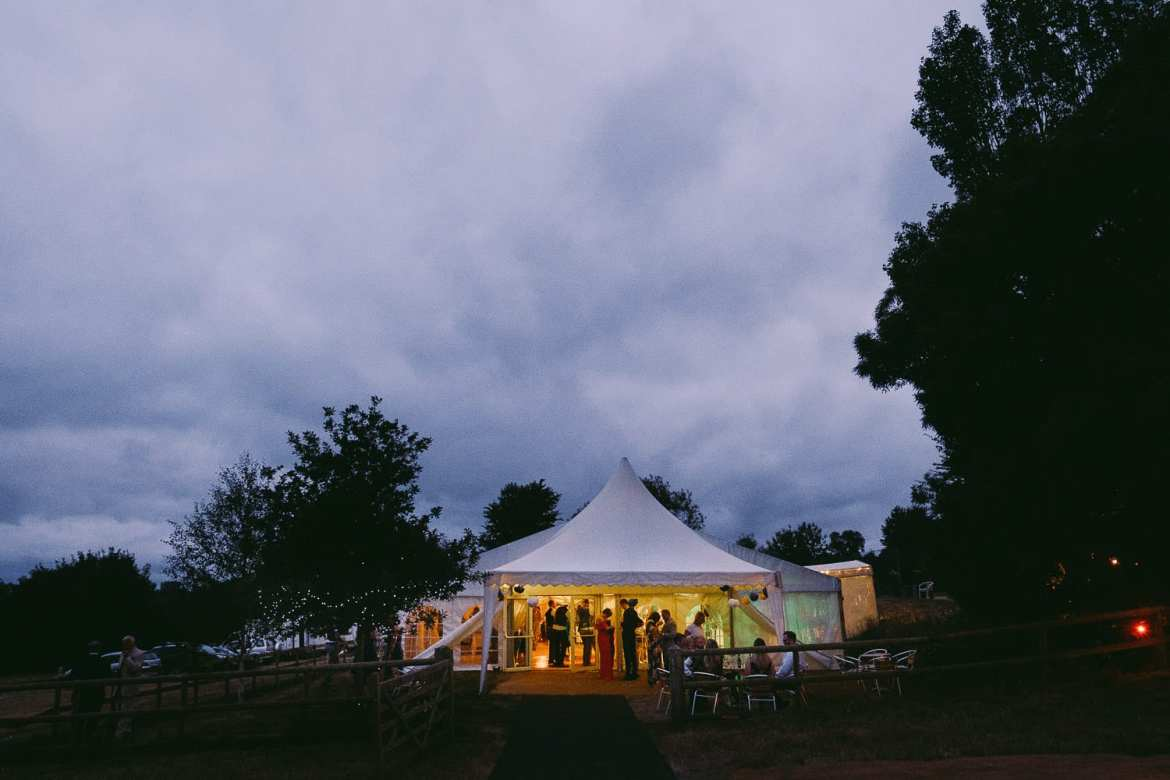 The garden marquee lit up in the evening