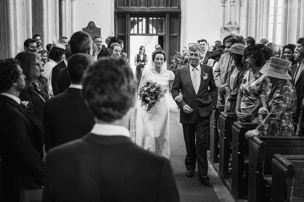 The bride walks down the aisle with her father