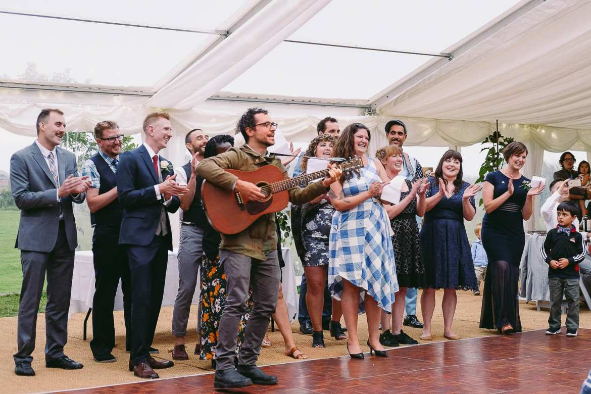 A flash mob band serenades the bride and groom